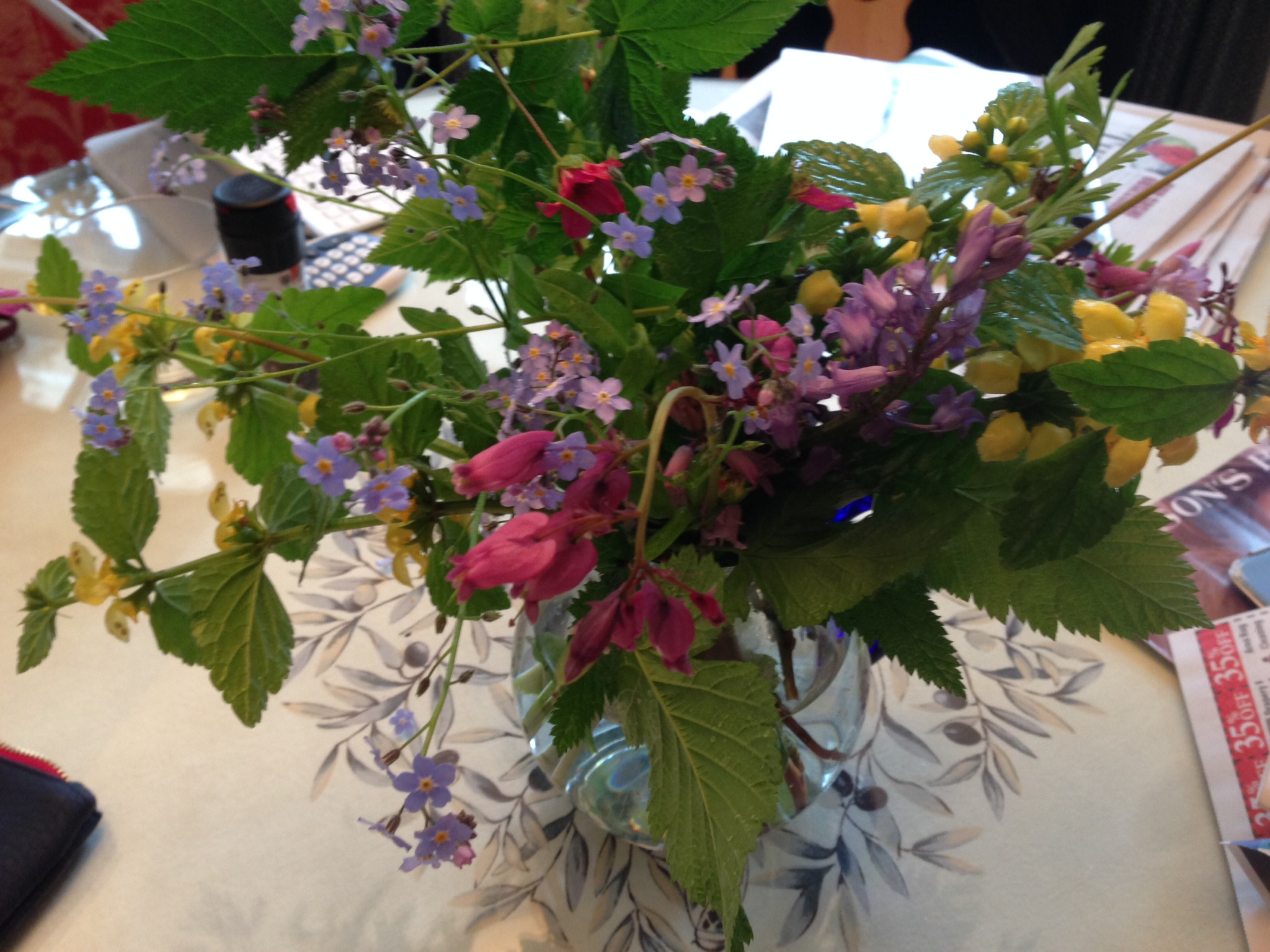 Mothers day hand picked bouquet  of spring flowrs picked by a daughter for her mum